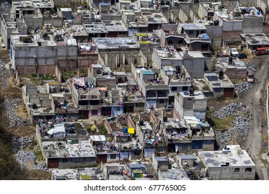 Aerial view of Mexico City figuring poor houses in slums like district