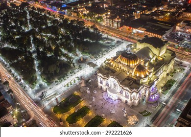 Aerial view of Mexico City, light trails and Bellas Artes.