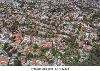 Aerial view of Mexico City over one family homes in middle class urban district