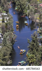 Aerial view of Mexico City over Xochimilco, a world cultural heritage site where you can take a boat trip on typical colorful boats through the channels and floating gardens