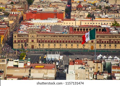 Aerial view of mexico city zocalo downtown with mexican flag.