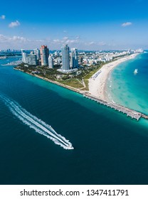 Aerial view of Miami Beach with speedboat in view
