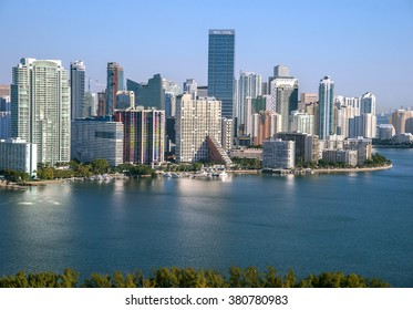 Aerial view of Miami skyline along Brickell Ave toward Biscayne Bay on cloudless morning, 2016