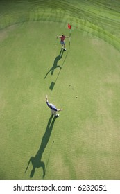 Aerial view of mid adult Caucasian man and woman being excited on golf course at Bald Head Island, North Carolina.