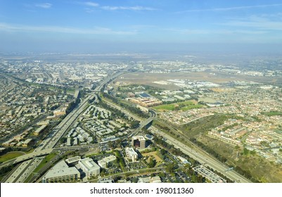 Aerial view of Midway District neighborhood and San Diego International Airport (Lindbergh Field), in Southern California, United States of America. Dominated by multi lane roads with heavy traffic