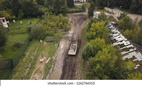 Aerial view military soldiers sittingon moving army tank on shooting training