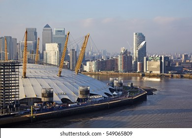 Aerial view of Millennium Dome (02 Arena) and financial district of Canary Wharf