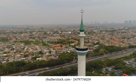 aerial view minaret mosque Al Akbar against city Surabaya highway, skyscrapers, buildings and houses. mosque in Indonesia Al Akbar in Surabaya, Indonesia. beautiful mosque with minarets on island Java