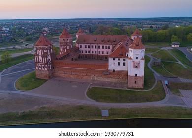 Aerial view of Mir Castle on April evening. Mir, Belarus - Shutterstock ID 1930779731