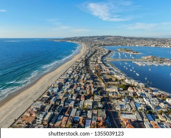Aerial view of Mission Bay & Beaches in San Diego, California. USA. Community built on a sandbar with villas, sea port.  & recreational Mission Bay Park. Californian beach-lifestyle.