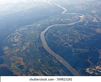 Aerial view of Mississippi River snaking around farmlands in Louisiana