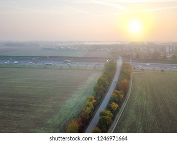 Aerial view of misty fields with motorway in the background