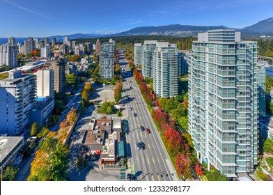 Aerial view of the modern city skyline of Vancouver, British Columbia, Canada during a sunny day.