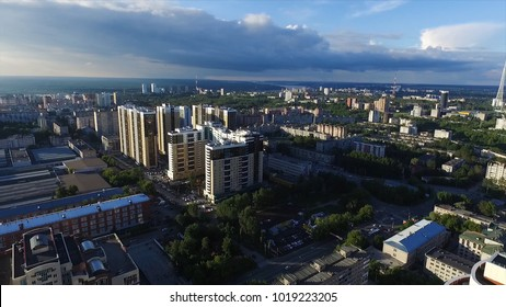 Aerial view of a modern city at sunset. Clip. Top view of the city in summer at sunset