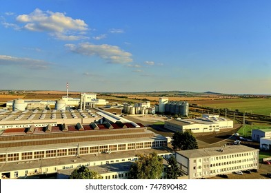 Aerial view of modern factory. Modern plant with blue sky
