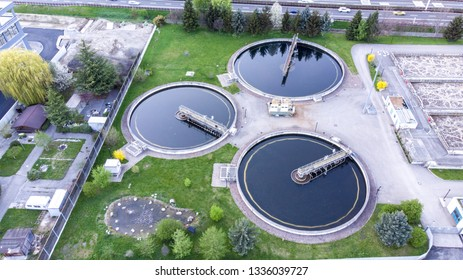 Aerial view of modern little industrial sewage treatment plant at work. Drone view recirculation solid contact clarifier sedimentation tank, Water treatment plant.