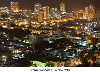 Aerial view of modern quarter of Vedado in Havana, Cuba, at night.