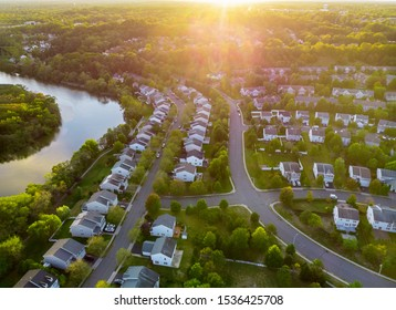 Aerial view of modern roofs of houses of residential area summer houses early sunrise