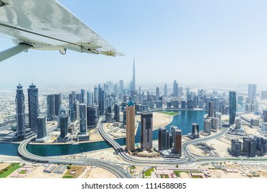 Aerial view of modern skyscrapers and sea in the background in Dubai, United Arab Emirates.