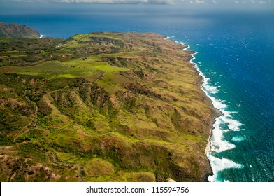 Aerial view of Molokai island coastline and lush hills