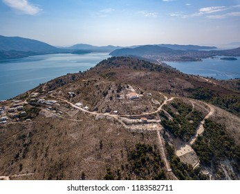 Aerial view of monastery with lake and beach in background (Saranda - Vlora - Albania)