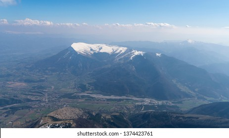 Aerial view of Montagne de Ceuse, a mountain in the French Alps with snow on the top.