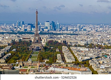 Aerial view, from Montparnasse tower, with Eiffel tower and La Defense district in Paris, France.