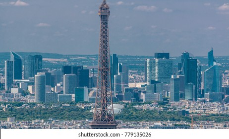 Aerial view from Montparnasse tower with Eiffel tower and La Defense district on background timelapse in Paris, France. Top view from observation deck at sunny summer day.