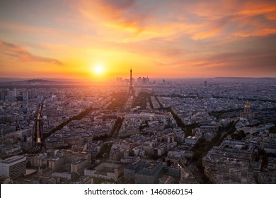 Aerial view, from Montparnasse tower at sunset and night sky, view of the Eiffel Tower and La Defense district in Paris, France