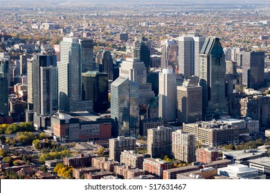 Aerial view of the Montreal city center skyline from the south west showing the recently built towers around famed Bell Center on a sunny autumn day, Canada.