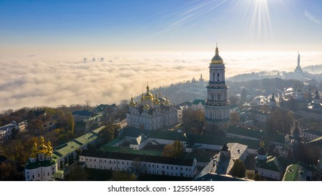 Aerial view of the Monument Motherland, shrouded in thick fog at dawn, Kiev, Ukraine. The concept of the apocalyptic doomsday.