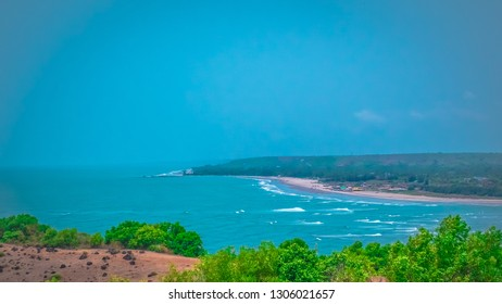 Aerial view of Morgim, Morjhim, and Ashwem beaches in the northern part of Goa from Chapora Fort Portuguese fortress near Vagator. Chapora river and Arabian Sea view from above in Goa, India.
