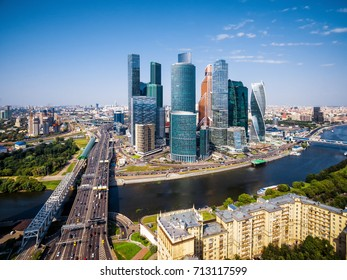 Aerial view of Moscow downtown in summer, Russia. Moscow skyline on a sunny day. Panorama of city with skyscrapers and Moskva River. Modern office and residential buildings in Moscow.