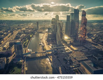 Aerial view of Moscow, Russia. Panorama of the city with Moskva River and business district. Moscow from above on a sunny summer day. Moscow skyline with modern urban buildings. Concept of finance.
