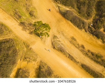 Aerial view of motocross bikes in racetrack. Outdoor motor sport from drone view.
