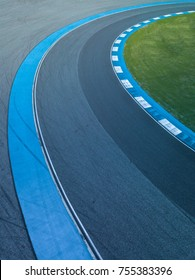 Aerial view motor race track circuit, Turning asphalt road with marking lines and tire marks, Motor race track asphalt international circuit.
