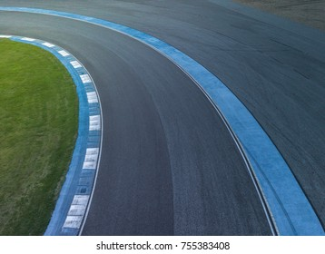 Aerial view motor race track circuit, Turning asphalt road with marking lines and tire marks.