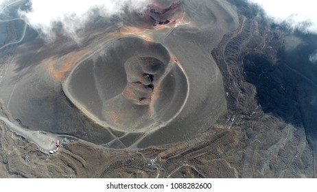 Aerial view Mount Etna volcanic crater one of the flank craters is roughly circular depression in ground caused by volcanic activity and is typically bowl-shaped feature also showing people walking