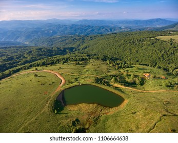 Aerial view of mountain lake with mountain relief in distance. Drone photography. Macedonia.