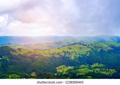 aerial view, mountain peaks in the fog and the dawn of the sun. Ukraine Carpathians