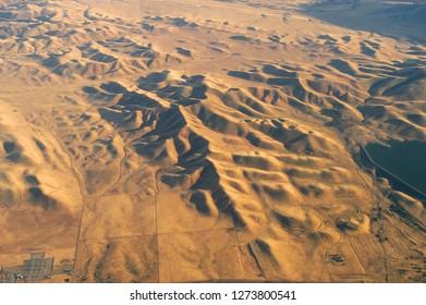 aerial view of mountain range in desert in California