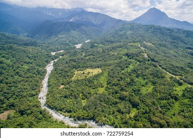 aerial view of mountain river flowing across tropical hills and boulders in Kota Belud Sabah Malaysian Borneo.