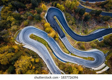 Aerial View Of Mountain Road With Hairpin Bends, Surrounded By Trees In Autumn Colors - Maloja Pass, Switzerland