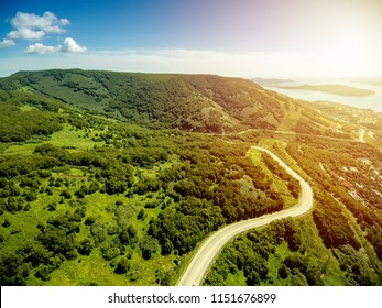 Aerial view at mountain road in sunny day