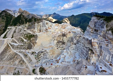 Aerial view of mountain of stone and marble quarries in the regional natural park of the Apuan Alps located in the Apennines in Tuscany, Massa Carrara Italy. Open pit mine