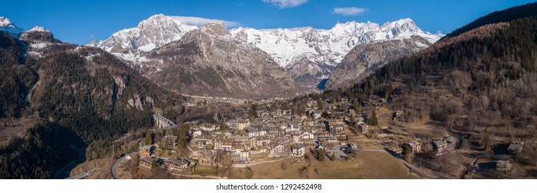 Aerial view of a mountain village in Aosta Valley with scenic view of Mont Blanc chain