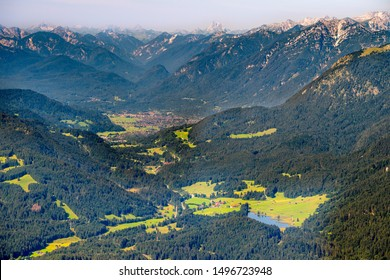 aerial view to mountain Zugspitze and city Garmisch-Partenkirchen in Bavaria, Germany