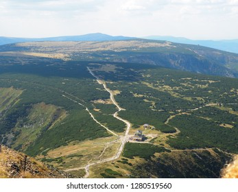 Aerial view of mountains, building with accommodation, shelter