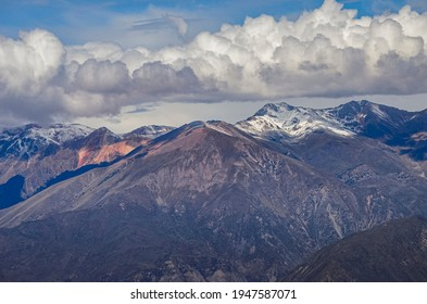 Aerial view of mountains and clouds in Colca Canyon region in Peru. Southamerican valley landscape