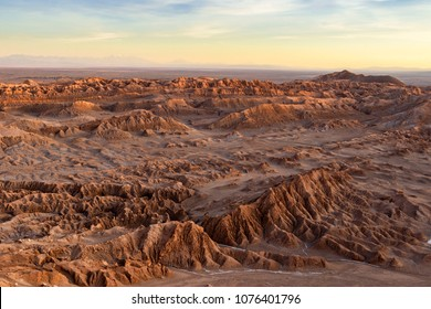 aerial view of mountains at dusk in atacama desert